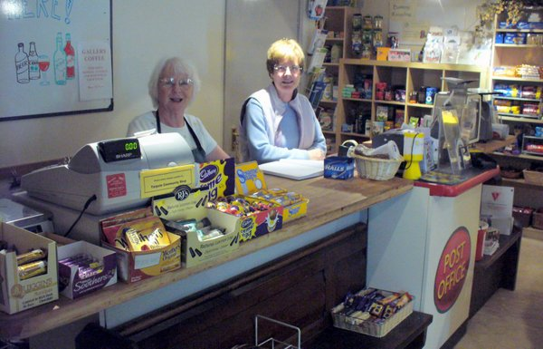 Volunteers serving at the Shop counter